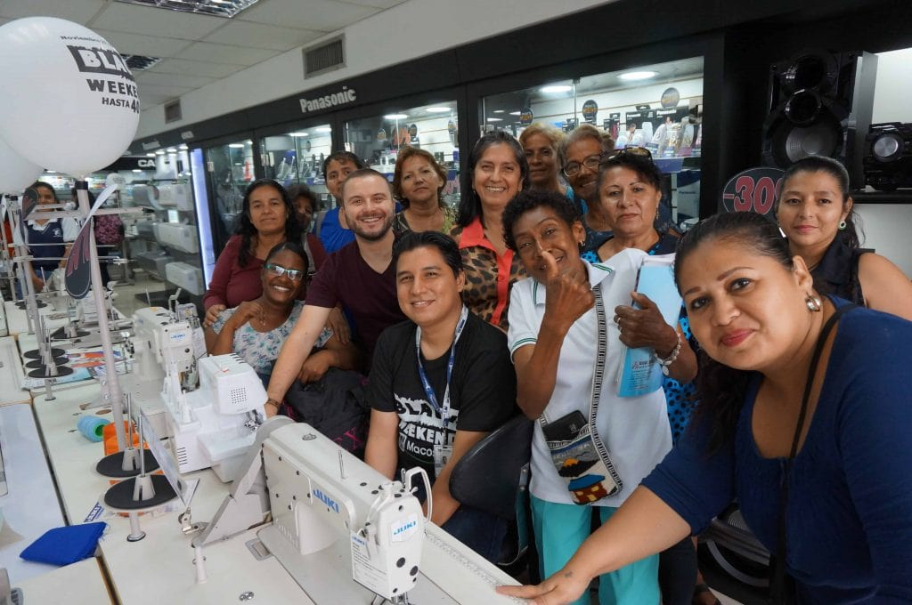 Ecuador. Jonathan visits sewing machine shop with women entrepreneurs