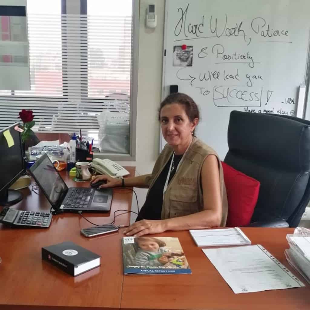 Picture of ADRA project manager Eliane Abikheir at her desk in Lebanon